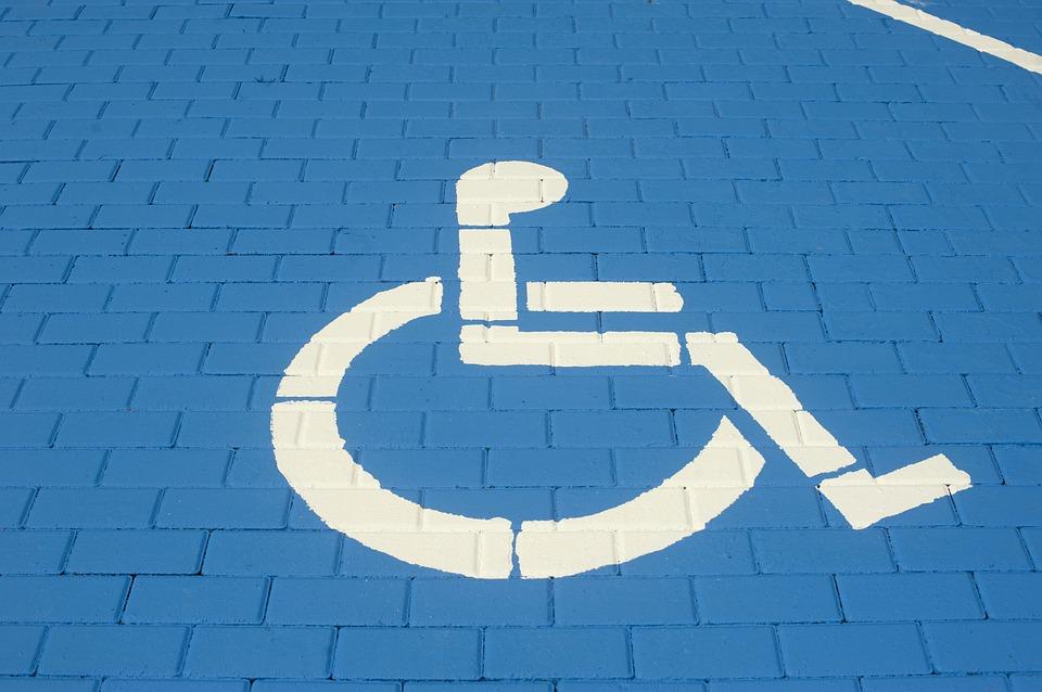 Dr. Handicap - Wheelchair Sign on Blue Brick
